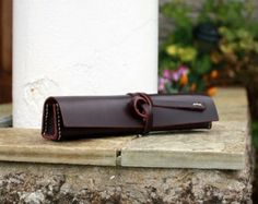 Hand-stitched  pencil case in dark purple leather