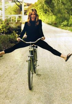 black cropped pants, black shirt, bike