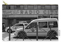 Vintage Radio City Music Hall exclusive carry-all pouch. Taxis line the street in front of the iconic Radio City Music Hall in this classic black and white New York City street scene. Exclusive design available only on Fine Art America and Pixels.com. https://andrea-rea.pixels.com/