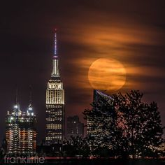 Full Moon near the ESB in New York City by Frank Little by newyorkcityfeelings.com - The Best Photos and Videos of New York City including the Statue of Liberty Brooklyn Bridge Central Park Empire State Building Chrysler Building and other popular New York places and attractions.