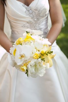 Love this for the bride's bouquet with the bridesmaids carrying an all yellow bouquet. And I love her dress