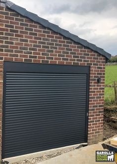 Roller Shutter Garage Doors are super easy to use, all you need to do is press a button! With Roller Doors you can enter your garage in style and ease. To find out more about our electric Roller Garage Doors, click the link below! Roller Doors, Roller Shutters, Black Garage Doors, Electric Rollers, Home Exterior Makeover, Shutter Doors, Curb Appeal, Super Easy, How To Find Out
