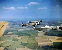 Three Supermarine Spitfires Mk VBs-ZD, - ZD-P - F & E of No 222 Squadron, RAF, based at North Weald, in 'vic' formation over the Essex, English countryside - World War 2