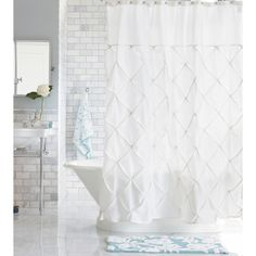 Give your bath a new look with the Threshold Pin tuck Shower Curtain. This pretty curtain adds a touch of casual elegance to your bathroom. Hooks, rod and liner sold separately.