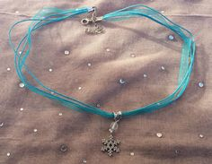 Sliver Snow Flake Ribbon Necklace by ShadowRevolutions on Etsy