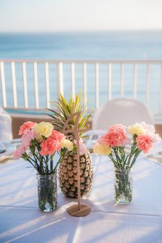 Tropical centerpiece idea - pineapples + mason jars with pink + yellow carnations {Studio 3511 Photography by Nicole Seu} Tropical Centerpieces, Wedding Centerpieces, Wedding Decorations, Wedding Cake Prices, Wedding Cakes, Wedding Stuff, Cute Wedding Ideas, Wedding Themes, Luxury Wedding Venues