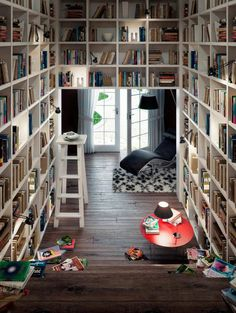 I love this hallway at the foot of the stairs. Great place for your books. Great use of a space and just great all the way around.