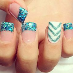 Really liking the glittery French tip nails; not so much the chevron stripes.