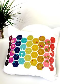 """Includes Bonus Hexie Flower Layout! Modern Hexies is a faster version of traditional english paper piecing, but with a modern spin. This pattern gives you full instructions for a decorative pillow, but can also be used to create your own Modern Hexies project. Video tutorial links included in PDF pattern sharing instructions and my favorite tricks. Skill Level: Easy to Intermediate Finished Size: 19.5"""" x 19.5"""" square Fabric Requirements: 1 yard of fabric for pillow 41 2.5"""" x 2.5"""" squares..."""