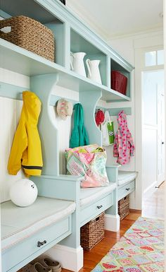 A perfect mudroom... love the colors & cubbies... its just adorable!