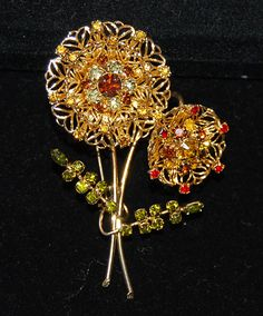 For your consideration is a very pretty signed alice caviness flower brooch. It is goldtone with several different colored rindstones.A very