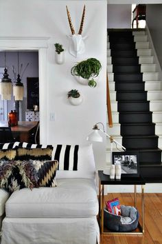 This floor is an open floor plan and having the steps painted was a great way of drawing your eye to the design of the decor. The planters are West Elm, the throw is from Ikea, the pillows are Anthropologie and Target. Inspiration Design, Decoration Inspiration, Interior Inspiration, Black And White Stairs, White Staircase, Black White, My Living Room, Living Spaces, Casa Loft