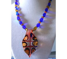 Glass pendant necklace Lt. Cobalt AB and gold glass beads, $20.0