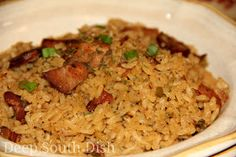 This nicely seasoned jambalaya, a rice-based dish similar to a low country purlow, starts with the classic trinity of vegetables, contains bacon, spicy andouille smoked sausage, and cubes of pork loin, and is baked to a fluffy perfection.