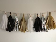 Black White Silver Gold Tissue Tassel Garland - 8 Tassels by #Likehearted, $25.00. Cute for New Years Decorations!
