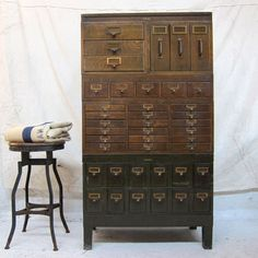 Love this!  Early 1900s modular stacking cabinet is from manufacturer Globe-Wernicke. Features modular units, each with various drawer sizes.
