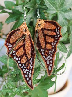 Hey, I found this really awesome Etsy listing at https://www.etsy.com/listing/159888308/fairy-wings-earrings-pumpkin-orange