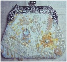 Beautiful and understated. I would take it as a clutch though it seems more a coin purse.. --  --  First Place: Emiko    CRAZY QUILTING INTERNATIONAL: purse contest