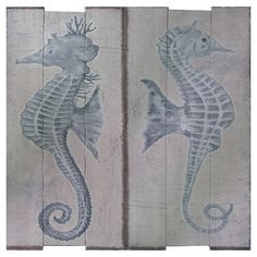 Two-piece weathered wall decor set with seahorse designs.     Product: 2 Piece wall decor setConstruction Material: MD...