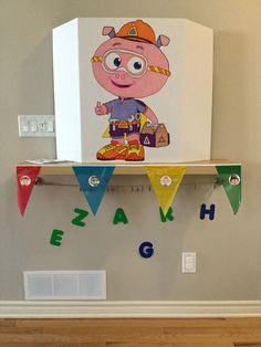 "Alpha Pig cardboard, Dollar Tree birthday banner with Super Why confetti glued on (printed online). Below are super letters, blue ones are collected throughout party after games to solve a ""problem""."
