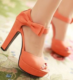 Platform sandals > heels. Ankle straps + peep toe in a lovely shade of coral with adorable bows. Cute and very girly!