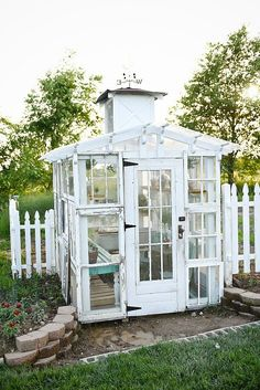 DIY rustic window greenhouse - Take the full tour of this hand built greenhouse made out of antique windows inside & out! Backyard Greenhouse, Small Greenhouse, Greenhouse Plans, Old Window Greenhouse, Homemade Greenhouse, Greenhouse Wedding, Antique Windows, Old Windows, Recycled Windows