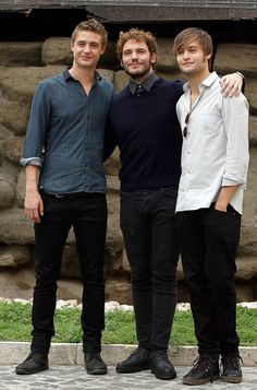 Sam had his arms around Douglas and Max Irons at the Rome photocall for Posh in September 2014.