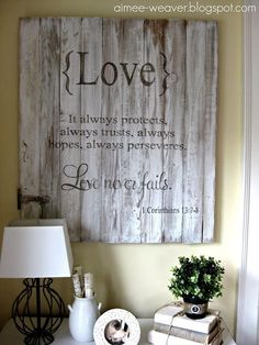 DIY Inspiration: Rustic LOVE scripture wall decoration. Use pallets or salvaged wood. Love the vintage door hardware piece in the bottom left. This would also look great with pieces of wood in varying widths or even separate width wood pieces painted in soft colors & distressed could be stunning! Would make an excellent wedding or anniversary present!! by Lydia Lane Jackson