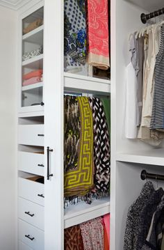 A pull-out, dual-sided scarf rack. To the left, are drawers for t-shirts and sweaters.