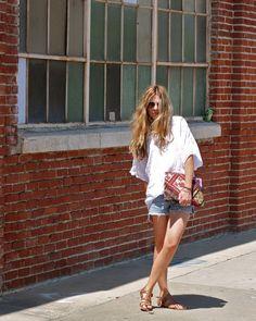 White crochet-detail blouse + vintage levi shorts + boho bag + studded sandals.