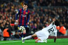 Lionel Messi of FC Barcelona competes for the ball with Marcelo Vieira of Real Madrid CF during the La Liga match Between FC Barcelona and Real...
