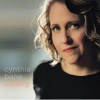 """Jazz vocalist Cynthia Bane's hip understated style and pure vocal tone appeal to a wide variety of jazz fans. Jazz singer Janet Planet proclaimed her """"a star whose voice defines swing elegance and taste.""""Her debut album """"Clearly"""" (Stellar! Sound Productions) provides the listener with an intimate view of Cynthia as a versatile jazz artist. Teaming up with renowned pianist John Harmon along with Andy Sachen (bass) and Mike Malone (drums) Cynthia skillfully delivers jazz standards bebop…"""
