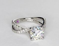 Dang that's beautiful!!!! Monique Lhuillier Twist Cathedral Diamond Engagement Ring in Platinum | Blue Nile
