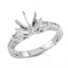 BF1386 - #23313  18 k, white diamond ring 0.27 ct. rounds 0.17 ct. baguette 0.11 ct. triangle (Please call for pricing)