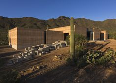 This vacation home blends into Arizona's Sonoran Desert with rammed earth walls made from local soil.