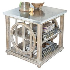 A chic addition to your living room or master suite, this metal-topped side table showcases an openwork base and 2 lower shelves for stacking magazines or re...