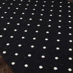 Handcrafted wool flatweave rug with polka dots.   Product: RugConstruction Material: 100% WoolColor: BlackFeatures:  ReversibleDurableEasy care Note: Please be aware that actual colors may vary from those shown on your screen. Accent rugs may also not show the entire pattern that the corresponding area rugs have.Cleaning and Care: Vacuum regularly. Blot spills immediately with mild soap and cold water to prevent shrinkage. Avoid direct sunlight to prevent fading.