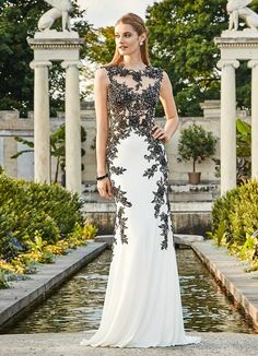 COLORS 1424 Jersey Sheer Lace Prom Dress Evening Gown. Jersey fabric evening gown with jeweled lace applique. The top features panels of sheer illusion. Available in Black/White and Royal. NOTE: The R