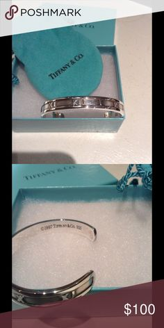 Tiffany Atlas Timeless cuff bracelet 925 silver Timeless Tiffany Atlas bracelet stamped 1997 Tiffany & Co. 925. Size small. This bracelet is no longer available at Tiffany. Tiffany pouch and box included. Received as gift a few yrs. ago. Developed arthritis in my hands and wrists and bracelet no longer fits. Was received as gift. Always kept clean and polished. Tiffany & Co. Jewelry Bracelets