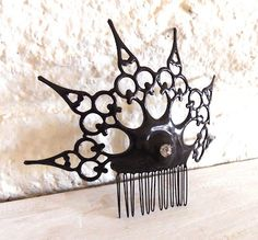 oooh, I need one of these! a steampunk peineta, now a mantilla would totally set off a steampunk flamenco dancer