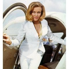 Pussy Galore  (Honor Blackman)  Goldfinger  1964    Yes, the best named Bond girl. In the original book she was the leader of a lesbian biker gang. I guess that was two risque for a 1960s film. I think she's also the only Bond girl who was older than the Bond she worked with (she was 39 to Connery's 34)