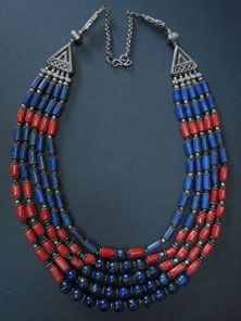 A five strand necklace I acquired in Nepal of Lapis and Coral with brass spacers between the beads. The necklace sits and hangs beautifully on the body. Finished with coin silver beads, chain and S-hook.