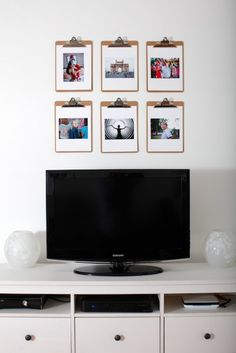 use clipboards to hang photos
