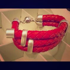 Red and Silver Genuine Leather Bracelet Bought it for $160 originally. Real braided bolo cord red leather bracelet with silver magnetic clasps and detailing. Accessories