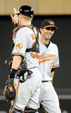 Matt Wieters and JJ Hardy celebrate an Orioles' win