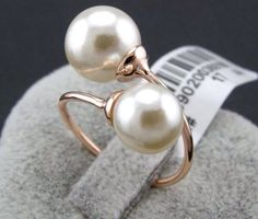 Double Pearl Ring Handmade Inspired by Chanel by GlitzGlamourCO... Two natural and different sized pearls would be beautiful and represent the love of two people.