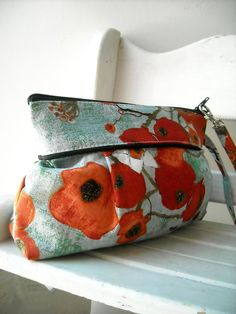 Poppy in Teal and Red Square Zipper Pouch....nice:)