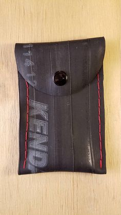 Handmade from up-cycled bike inner tube.