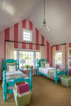 """Soaring pink stripes direct the eye up to the impressive vaulted ceilings. """"I'm usually a horizontal stripes person but we chose to use vertical stripes because the room has these beautiful vaulted ceilings that should be accentuated rather than pulled down,"""" says interior designer Linda Woodrum."""