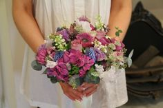 Glorious wedding bouquet included a luscious collection of Anemones, Memory Lane Roses, Lavender, Lily of the Valley, Hydrangeas, Hyacinths, Sweet Peas, Astrantia, Lily of the Valley, Muscari and Lilac with Eucalyptus